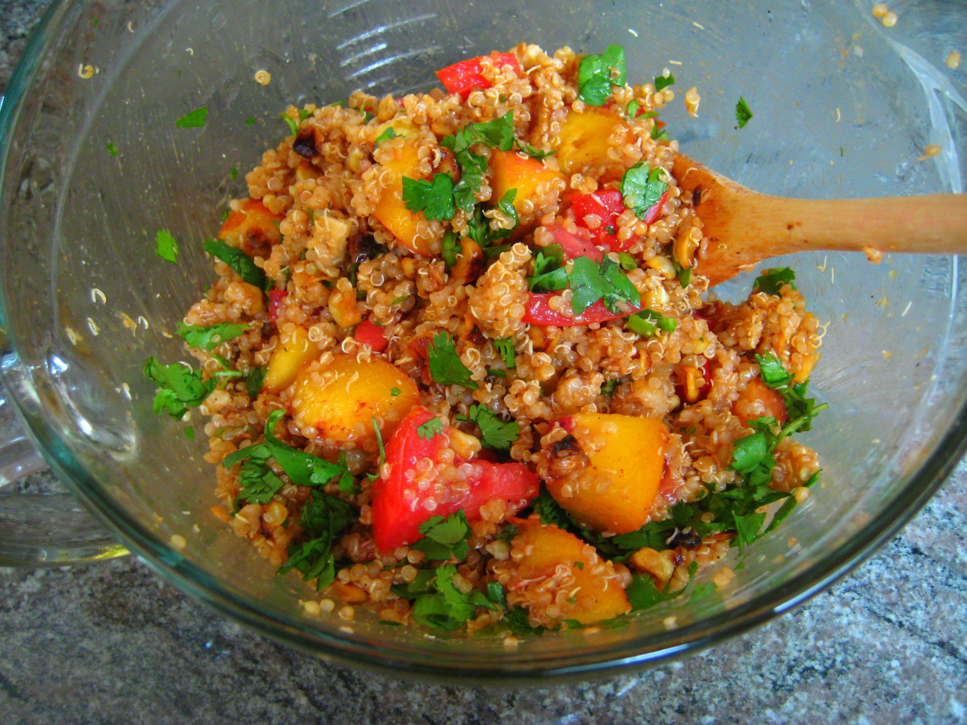 vegan barbecue quinoa salad with peaches, corn, and tomatoes